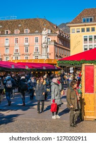 Christmas market in Bolzano on a sunny winter day. Trentino Alto Adige, Italy. December-12-2018