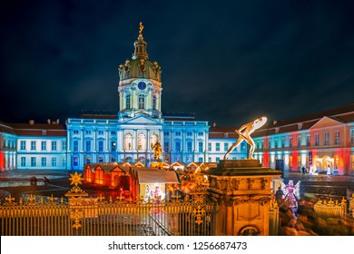 Christmas market of Charlottenburg Palace at night in Berlin, Germany