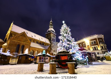 Christmas market at Dome square in Old Riga, Latvia at winter night