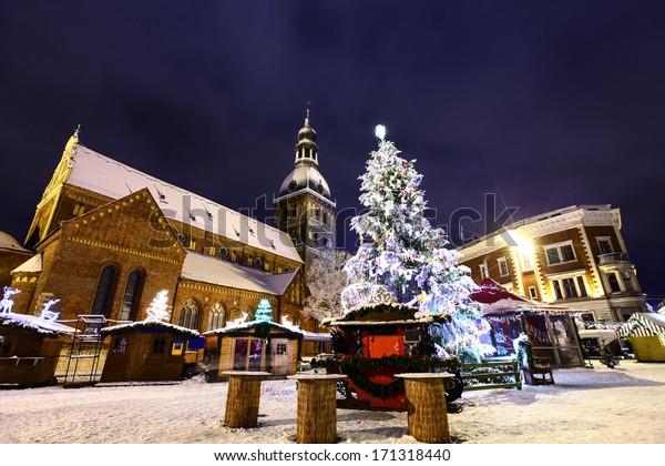 Christmas market at Dome square in Old Riga, Latvia at winter night