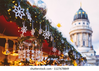 Christmas Market in Gendarmenmarkt square in Winter Berlin, Germany. Advent Fair Decoration and Stalls with Crafts Items on the Bazaar.