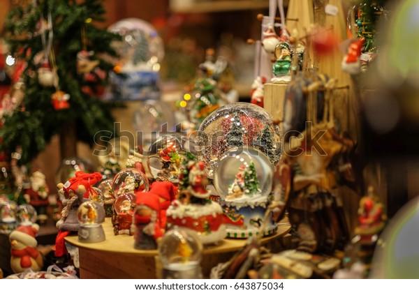 Christmas market, London, United Kingdom - Dec 27, 2016 - A lot of crystal ball music box with snowflake romantic Christmas gift New year