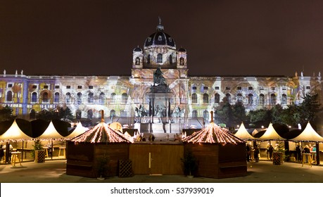 Christmas market at the Maria Theresa Square in Vienna - Wien, Austria, Europe 2016. Natural History Museum visible in the back.