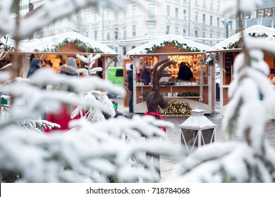 Christmas market stall with Christmas trees covered with snow and Xmas decorations