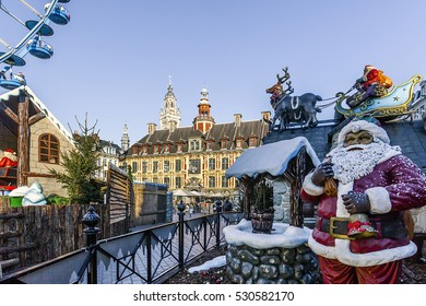 Christmas market with these country cottages, these attrations and celebrates it sledge filled with toys for the children. FRANCE - Lille November 2016