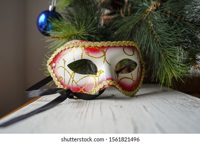 Christmas mask on a white Board on the background of a pine branch