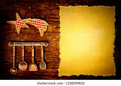 Christmas menu dinner background. Star cloth tablecloth and old kitchen utensils hanging on a rustic wooden wall with blank parchment paper