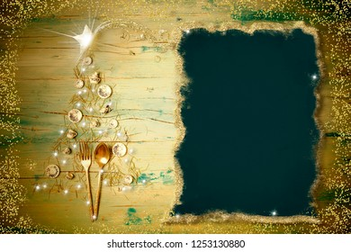 Christmas menu dinner background. Christmas tree made with plates, cups and cutlery with a blank background for writing