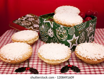 Christmas mince pies on a plate with icing sugar on top