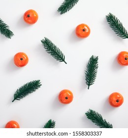 Christmas minimal concept - Christmas composition made of tree branch and tangerine on white background. Rustic christmas pattern top white for concept design. Christmas background.