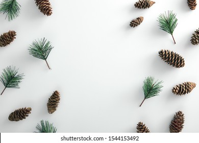 Christmas minimal concept - pattern with pinecone and pine branch on white background. Horizontal mockup with copy space, design for any purposes.. Winter christmas holiday background. Flatlay pattern