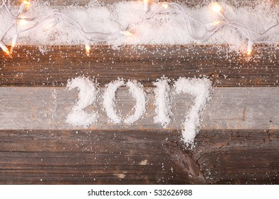 Christmas mood Happy New Year 2017 holiday. Background with 2017 snow figures