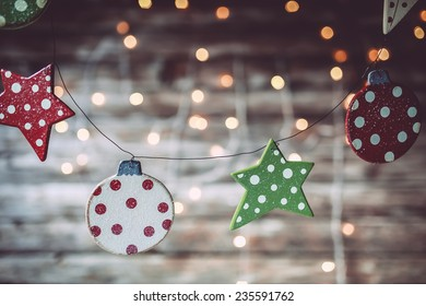 Christmas mood wooden painted ornaments on a wooden background
