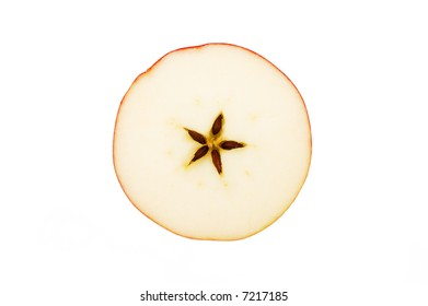 christmas motive - cross section of red apple on white background