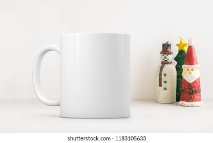 Christmas mug mock-up. White blank coffee mug to add custom design or quote. Perfect for businesses selling mugs, just overlay your quote or design on to the image.
