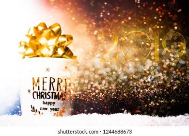 Christmas mug wth christmas cockade decoration, cozy home chrismtas, against a bokehlicious golden background warm tone.