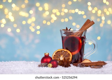 Christmas mulled wine in glass with festive decoration