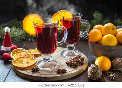 Christmas mulled wine and tangerines on a dark background.