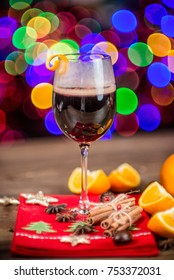 Christmas mulled wine. Traditional christmas mulled wine with colorful bokeh and with christmas festive holiday decor and holiday background