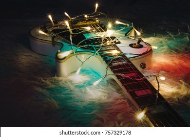 Christmas music concept. Ukulele with decoration. Gift guitar classic shapes for Christmas or new year.