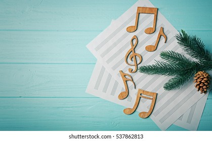 Christmas musical composition on wooden background