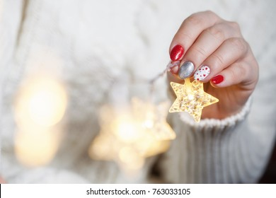 Christmas Nail art manicure. Winter Holiday style bright Manicure with dots