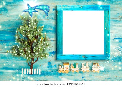 Christmas Nativity photo frame greetings. Christmas tree and vintage style wooden train with empty photo frame to put photo or message