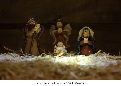 Christmas nativity scene of baby Jesus in the manger. Statuettes colored figures. Infant Jesus in the crib, Joseph and Mary figurines