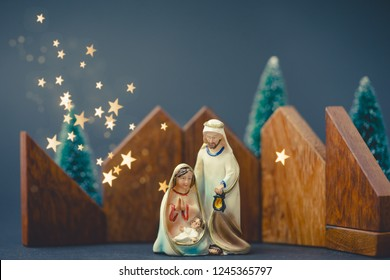 Christmas nativity scene of born child baby Jesus Christ in the manger with Joseph and Mary.Traditional Christmas Nativity Scene of baby Jesus in the manger with Mary and Joseph.