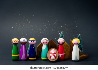 Christmas nativity scene of born child baby Jesus Christ in the manger with Joseph and Mary and Three wise men.Traditional Christmas Nativity Scene of baby Jesus in the manger with Mary and Joseph.
