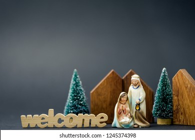 Christmas nativity scene of born child baby Jesus Christ in the manger with Joseph and Mary and welcome word.Traditional Christmas Nativity Scene of baby Jesus in the manger with Mary and Joseph.