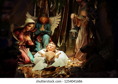 Christmas Nativity scene in the church, virgin Mary and Saint Joseph with Holy infant Jesus