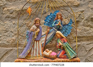 Christmas Nativity scene with The Holy Child, The Blessed Virgin Mary and Saint Joseph on grunge wall