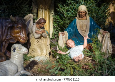 Christmas nativity scene with Mary and the Angel Gabriel looking down on baby Jesus in his manger