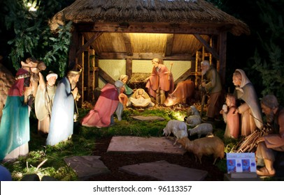 Christmas nativity scene with three Wise Men presenting gifts to baby Jesus, Mary & Joseph