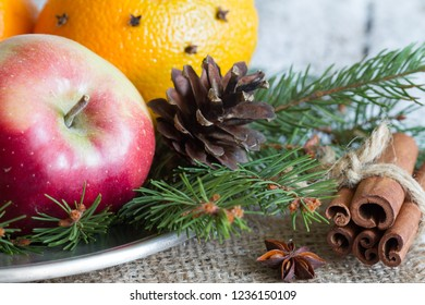 Christmas natural eco ornament with organic fruits on the snowy old table