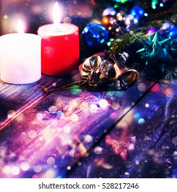 Christmas, New Year. Christmas background. Burning candles, gifts, christmas bell, Christmas tree decorations outside. free space for text.