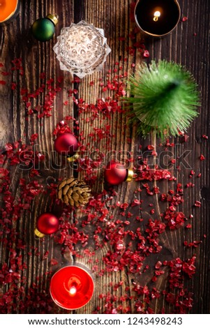 christmas or new year background with decorations on wooden table with warm lighting