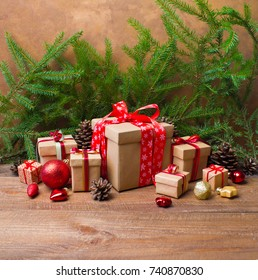 Christmas or New Year background: gifts, colored glass toys and balls, decoration on wooden background