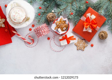 Christmas or New Year background with hot chocolate or cocoa and gingerbread cookies. Preparing gifts for Xmas celebration. Copyspace, overhead shot.