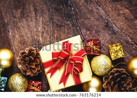christmas or new year background with pine conesgift box on red ribbongolden
