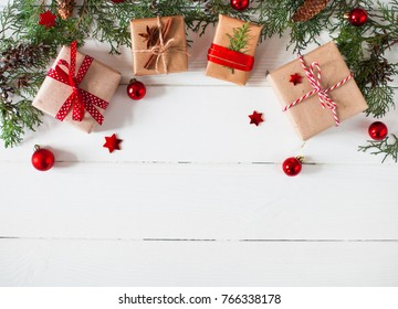 Christmas or New Year background, plain composition made of Xmas decorations,  gift, and fir branches, flat lay, blank space for a greeting text