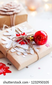 Christmas and New Year background with presents and decorations for Christmas tree. Holiday background with stars confetti and light bulbs. Place for text.