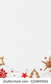 Christmas and New Year background with sparkling fir tree, heart, snowflakes and star confetti. Holiday symbols on white background with place for text.