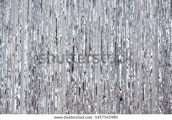 Christmas, New Year background and texture. Silver tinsel or shiny ribbons