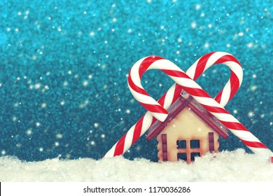 Christmas, New year background, toy house and two striped lollipops, retro style, selective focus