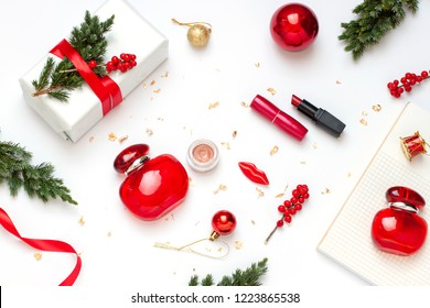 Christmas, New Year beauty concept flat lay with cosmetic gift for her. Winter holiday top view fashion composition