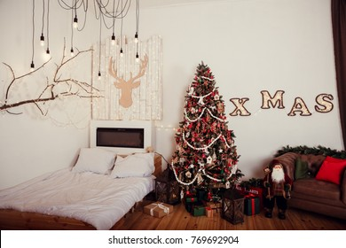 Christmas and New Year bedroom decoration with tree, bed and garland