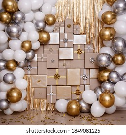 Christmas, new year or birthday background - wall decoration in golden and silver color with gifts and air balloons