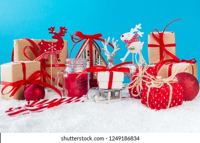 Christmas or New Year blue background with festive gift boxes. Holiday Christmas concept.